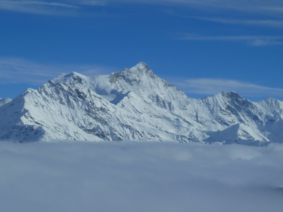 Weisshorn towers above the clouds