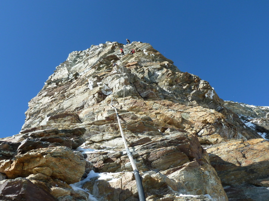Fixed ropes, Matterhorn. Guided climbing alps