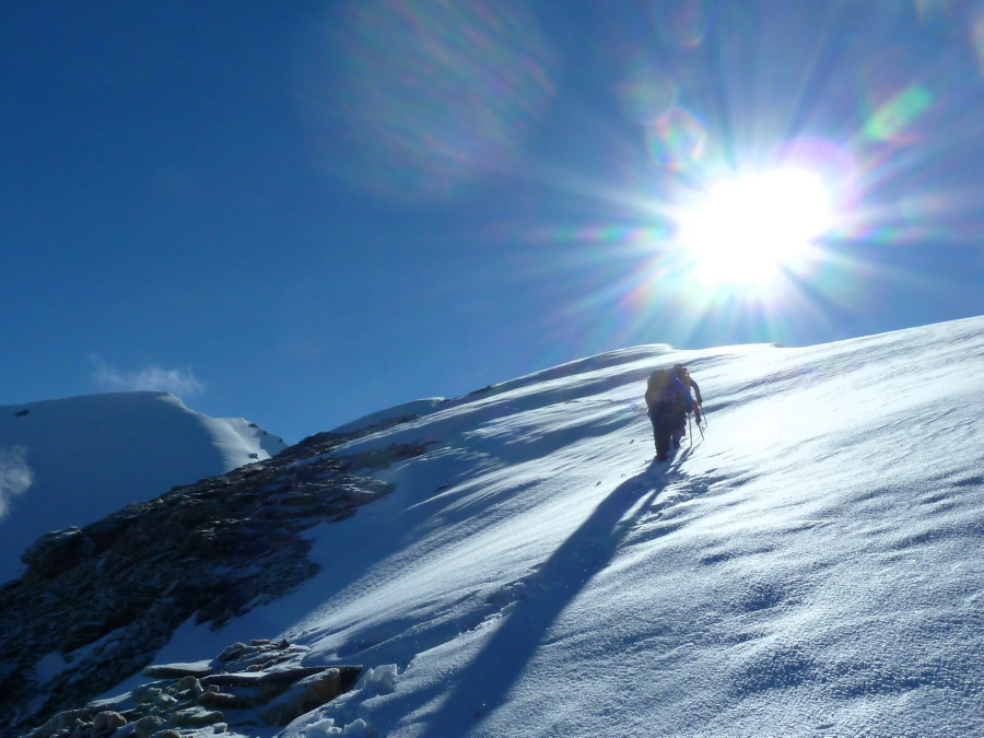 Emerging into the sun on the start of the summit ridge