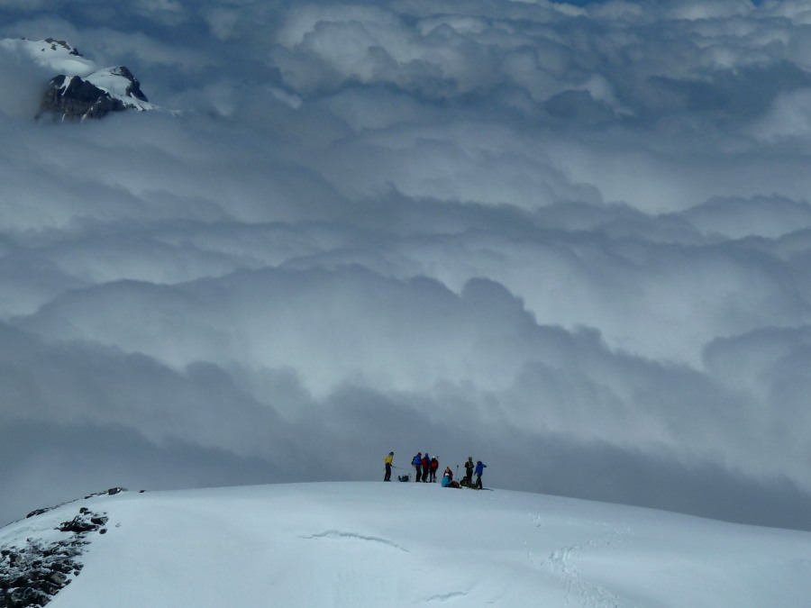 Teams above a sea of clouds
