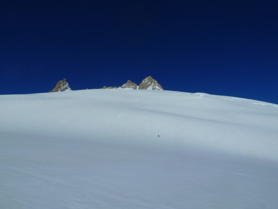 Tiny skiers on the vast slope below the Aiguille du Tour