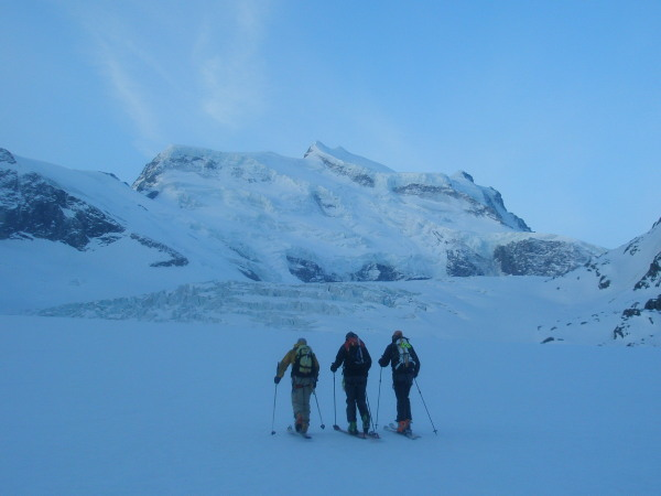 Skinning up the  Corbassiere glacier in the early morning