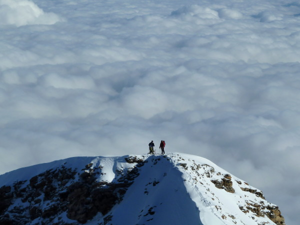 Following team above the clouds