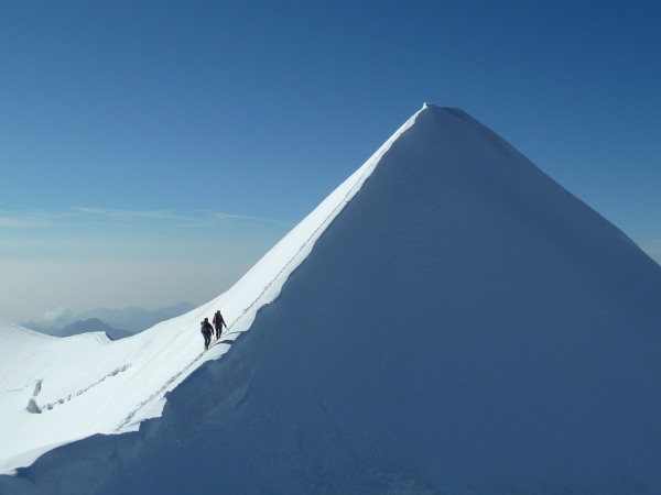 As we descend another team go up the summit ridge