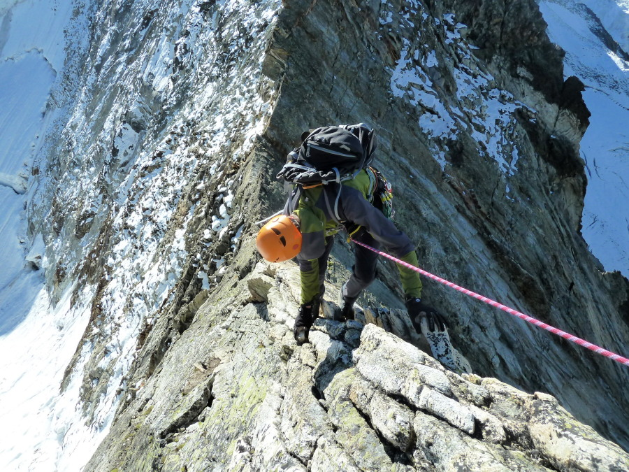 Down-climbing the fine arete that leads to Blanc de Moming