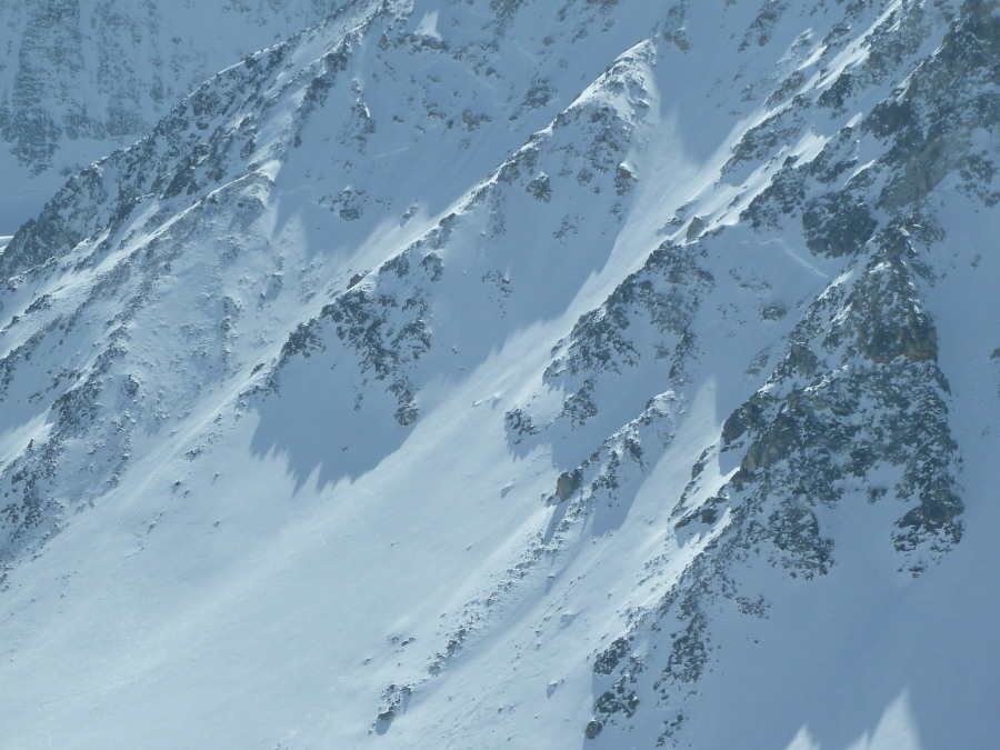 Spot the snowboarder in the huge north face of Tseina Reifien